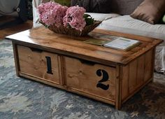 Diy coffee table via Anna White. Hmm paint bottom half white and stain the top a dark walnut.awesome DIY coffee table with storage