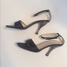 """Prada Black Satin Ankle Strap Heels Open toe, closed heel with adjustable ankle strap. They appear to have been professionally  resoled. Timeless and versatile wardrobe staple! Insole measures 9.5"""", width is 3.25"""", heels are 4"""". Euro size 37.5. Prada Shoes Heels"""
