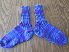 Here is a wonderful pair of hand knit adult size socks. Heel to toe is approx. 9 1/2 in. and the ribbing on the top (top to ankle) is approx. 7 in. The yarn color is called Grape Fizz. These socks are made of 100% acrylic yarn and can be machine washed and dried.