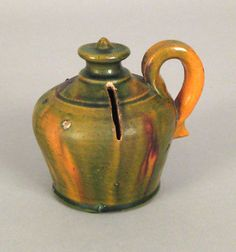 """Realized Price: $1053 Pennsylvania redware bank, 19th c., possibly Wagner pottery, 3 3/4"""" h."""