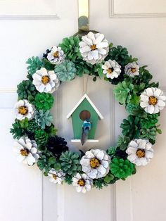 This adorable daisy pine cone wreath with birdhouse will make you smile any day of the year. Pine cones are hand painted and glued so it is not recommended for outdoor use. Put it anywhere inside to brighten up your day. This wreath measures x Pine Cone Art, Pine Cone Crafts, Wreath Crafts, Diy Wreath, Pine Cones, Pine Cone Wreath, Pine Cone Decorations, Christmas Decorations, Spring Front Door Wreaths
