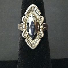 """VINTAGE Victorian Revival / Navajo Hematite Ring This 1930s or 40s silver beauty has a 3/4"""" faceted marques hematite set in a beautifully detailed setting. It both reminds me of Navajo styles and of Victorian mourning jewelry. It is marked sterling and has the stamp of Bell Trading Company which was founded in 1932 by Jack Michelson and his wife Mildred Bell in Albuquerque, NM. They specialized in Native American Jewelry tourist locations throughout the Southwest. This ring is heavily…"""
