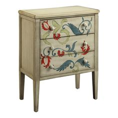 Hand-painted chest with a scrolling leaf motif and reeded column detailing.   Product: Accent chestConstruction Material...