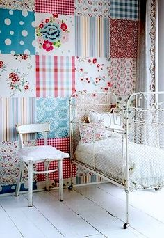 Scrapbook paper feature wall - great idea for kids room or playroom. Maybe with maps or music paper in a library or study. Would be a pain to get off again, but looks cool