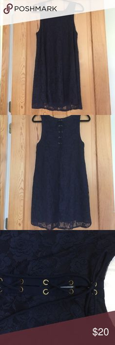 Navy Lace, Lace Up Back Shift Dress Classic shift dress in a deep navy blue lace. Lace up detail on back, could also be worn in front. Navy chiffon underlay provides coverage. Can fit a Medium Size too! Great Condition! OFFERS WELCOME! Forever 21 Dresses