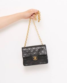 "This vintage Chanel 7"" mini classic flap bag is beautifully constructed in butter soft lambskin leather with trademark 'Matalasse' diamond... £1895"