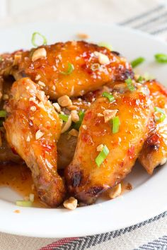 Sweet Chili Baked Chicken Wings c. Thai sweet chili sauce (recommended: Mae Ploy Brand) tsp light soy sauce to 3 tsp ground fresh chili paste (Sambal), depending on desired spice level 1 lb. Asian Chicken Wings, Cooking Chicken Wings, Baked Chicken Wings, Chicken Wing Recipes, Sweet Chili Chicken, Thai Sweet Chili Sauce, Sweet Thai Chili Wings Recipe, Chili Sauce Recipe, Soy Sauce