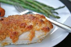 hellmans mayo chicken:: 2 chicken breasts, cut in half, 1/4 cup light mayonnaise, 1/4 cup parmesan, 1 teaspoon paprika, pepper. Pre-heat oven to 425 degrees. Mix mayonnaise, parmesan and seasonings together. Spread parmesan mixture over chicken and bake for 25-30 minutes until golden brown and cooked through.