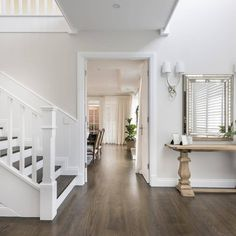 Warm, inviting and perfect for a busy family, this elegant home brings a softer touch to classic Hamptons styling. Hamptons Style Homes, Hamptons Decor, The Hamptons, Custom Home Designs, Custom Homes, Custom Design, Dark Timber Flooring, Coastal Bathrooms, Floor Colors