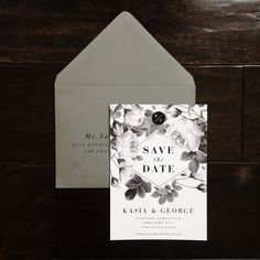 Become absolutely smitten with these Mod Black and White Botanical save the date invitations. The front showcases classic typography and monotone