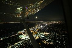 San Francisco Bay is a unique place to fly, and Paul De Zan captures a lot of the activity in this week's Friday Photo. From the dark water to the shining city lights to the airliners landing at SFO, it's all visible from the cockpit of a Cessna 172. Off in the distance, a warm moon rises from the horizon.