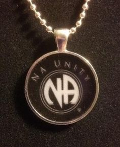 Rock your recovery with this cool, NA Unity Necklace. The pendant is a 1 circle, clear resin design on a silver tone base. 24 silver ball chain is