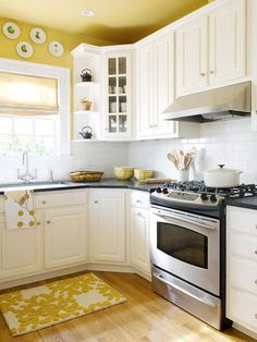 Yellow and white kitchen; love the corner shelves to hold tea pots!