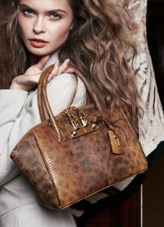 @}-,-;-- brown leather