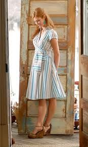 This dress is modest and simple, it covers a large part of the body, but it is also feminine and attractive because it shows the womanly shape and is worn with heels. The tied wrap adds a bit of much-needed spice.