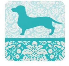"Keep your furniture water ring free and your guest smiling with our adorable set of six wiener dog coasters. These 3.8"" x 3.8"" high gloss plastic and have a cork back to prevent skidding."