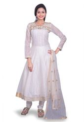 Embrace the festive colors wearing this Three quarter sleeve, Anarkali Kameez in Off White. The neckline and hemline are finely accentuated with Golden Zari and Thread in Ornamental and Abstract motifs. The lining of this Art Chanderi Silk attire is Cotton. It is accompanied by a Taffeta Churidar in Off White and a Net Dupatta in off white. Do Note: Slight variation in actual color vs. image is possible.