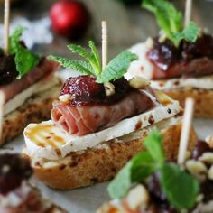 Cranberry, Brie, and Prosciutto Crostini with Balsamic Glaze.