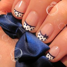Cute french manicure with little blue polka dots and tiny blue bow.