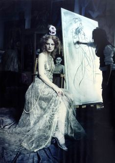 Guinevere van Seenus being drawn in a Haute Coture Supplement for Vogue Italia, March 2014. Photographer: Paolo Roversi. Portrait couture. Imagine an atelier of a painter at the end of the 19th century. Profile of a woman in the style of Boldini,...