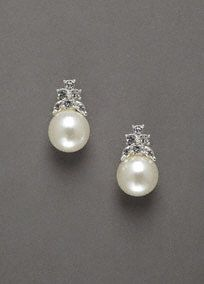An update to the classic pearl, perfect for the bride who loves both pearls and crystal in a classic form! Beautiful pearl stud earrings with crystal cluster accent. Imported. Available in Silver. $15