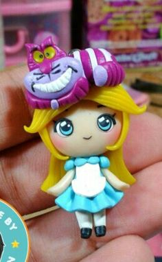 Polymer clay Cheshire cat & Alice by fern