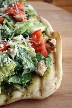 chicken-caesar-salad-pizza 6/19/14 outstanding! Rolled dough into 4 thin crusts and grilled w evoo sp topped w ckn (marinated in evoo lemon sp) mozz, then topped w tossed cesar salad and tomatoes with homemade cesar dressing....yum!!!! Just dont over do the crusts or they are too crunchy and harder to cut/bite.