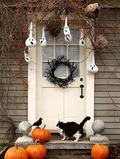 Eerie entry with ghostly gourds. Details: http://www.midwestliving.com/homes/seasonal-decorating/easy-fall-decorating-projects/page/3/0#