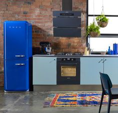 RETRO-INSPIRED SMEG FRIDGES: loving this bold blue #smeg refrigerator in a #kitchen with exposed brick
