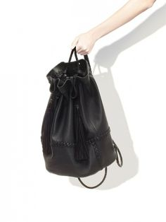 Zara has everything you need — including this awesome leather bucket bag // Leather Bucket Rucksack with Tassels by Zara