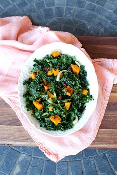 Kale, butternut squash, and cranberries make for a pretty and filling salad. #kale #salad #recipe