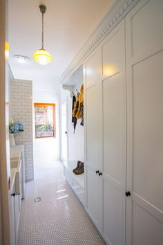 Consider styling your laundry in white tiles from the walls to the floor for a European mudroom look. Design Mark Stehbens Photography Shaun Murray Statement tiles in white laundry/mudroom Laundry Room Storage, Laundry Room Design, Laundry In Bathroom, Laundry Nook, Laundry Cabinets, Garage Storage, Storage Shelves, Hall Cupboard, Linen Cupboard
