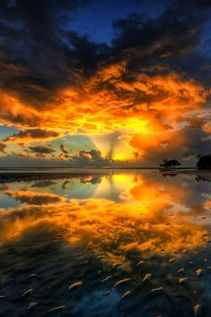 Something wonderful in that no two sunsets are exactly alike.  Gorgeous reflection.