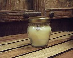Soy wax scented candle in a small ocrio jar with lid
