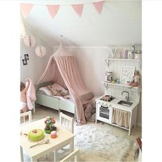 Little girls bedroom with cute kitchenette