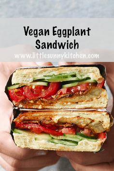 This vegan eggplant sandwich is so delicious that you'll keep making it over and over again. Layers of smoky and fresh vegetables are packed in panini bread, then toasted till perfection! Ideal for lunchboxes, picnics, and lunches on the go! #vegansandwich #veganeggplant #picnicsandwich