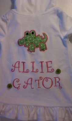 Appliqued and embroidered back to terrycloth swim cover for Allie.  Button flowers.