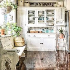Isn't this a beautiful kitchen nook chock full of farmhouse style and vintage charm? That gorgeous wood floor is so… Antique Kitchen Cabinets, Kitchen Cabinet Design, Vintage Kitchen, Farmhouse Style Kitchen, Farmhouse Kitchen Decor, Antique Farmhouse, Rustic Kitchens, Farmhouse Plans, French Farmhouse