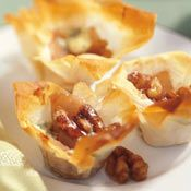Walnut Baked Mini Filo Tartlets -   I've never heard of the Mirabo Walnut cheese in this but it sounds like great.
