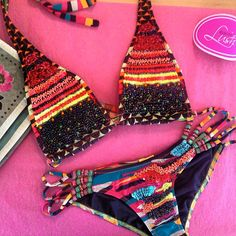 Hand-beaded gorgeousness courtesy of Agua Bendita Swimwear. Obsessed with this neon bikini!