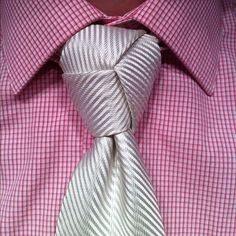 "Do you ever go into a formal or business casual environment and have someone say ""Wow man, awesome knot, how do you do that?"" Not wearing that Double Windsor you haven't. Well finally, now that you are able to tie the Trinity knot after watching my handy demonstration, you can have that warm fuzzy feeling. Go forth, be proud, and get adored for your amazing swagger."