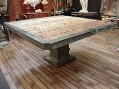 """1930 Large Square Industrial Table from France. Base and frame of table top made in steel with original old green patina. The top has inlaid old planks. A very """"cool"""" one-of-a-kind table perfect for an office, library, fun room or even a kitchen. $6980"""