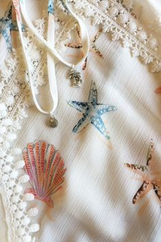 lace and seashells on cheesecloth