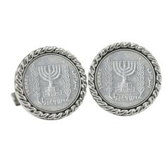 The Israel 5 New Agorot Coin cufflinks display the menorah on the coins. The coins are set in a silver tone rope bezel and have a bullet back. The coins are composed of aluminum, minted 1980-1985. A Certificate of Authenticity is included.