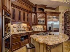8 SOVEREIGN CIR RICHMOND, TX 77469: Photo This kitchen is the heart of the home.