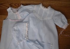 pintucked and embroidered baby daygown and bonnet with matching slip.