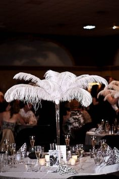 ostrich feather centerpieces, old Hollywood reception, 20's, damask, tables named after movie stars