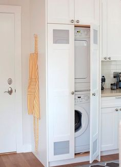 Enclosed washer/dryer and cabinets all around