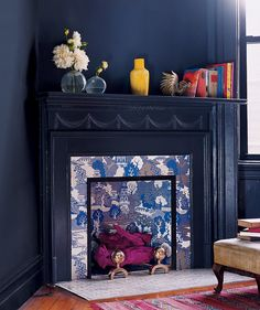 """from Domino Magazine: unused fireplace + wallpaper in a busy pattern + magenta-painted """"logs"""", photo by ANNIE SCHLECHTER Best Removable Wallpaper, Peel And Stick Wallpaper, My Living Room, Living Room Decor, Dining Room, Wallpaper Fireplace, Unused Fireplace, Fireplace Ideas, Fireplace Decorations"""