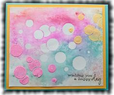 Dylusions spray with a little water on the back and run through the Big Shot!  The raised bubbles are with paste.